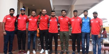 Manpreet Singh (C) and other members of the Indian hockey team pose at the BPIA upon their arrival, Monday