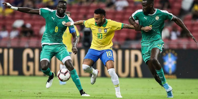 Neymar (No. 10) trying to get past two Senegal players during the game, Thursday