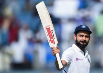 India's cricket team captain Virat Kohli rises his bat as he leaves the field after declearing their first innings during the second day of the second Test cricket match between India and South Africa at Maharashtra Cricket Association Stadium in Pune on October 11, 2019. (Photo by Punit PARANJPE / AFP) / IMAGE RESTRICTED TO EDITORIAL USE - STRICTLY NO COMMERCIAL USE
