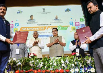 Union Minister for Road Transport and Highways and Micro, Small and Medium Enterprises, Nitin Gadkari witnessing the exchange of the agreements, at the inauguration of the Conference on 'One Nation One Fastag', in New Delhi, Monday