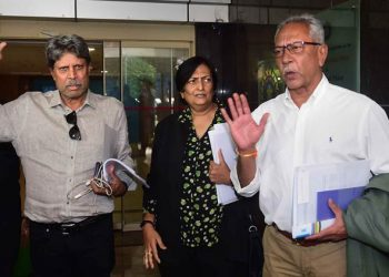Mumbai: Former India captain Kapil Dev, who is the Chairman of Cricket Advisory Committee, along with Anshuman Gaekwad and Shantha Rangaswamy leave the BCCI headquarters after conducting interviews for team India head coach post, in Mumbai, Friday, Aug. 16, 2019.  (PTI Photo/Shashank Parade)(PTI8_16_2019_000083B)