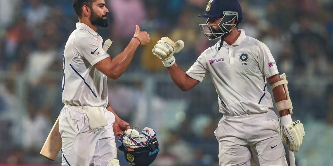 Virat Kohli and teammate Ajinkya Rahane return to the dressing room at the end of the first day against Bangladesh, at Eden Gardens in Kolkata, Friday