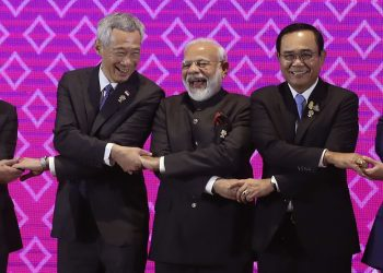 Prime Minister Narendra Modi shares a light moment with heads of state of other ASEAN countries