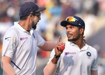 Fast bowlers Ishant Sharma (L) and Umesh Yadav have a lot to talk about after their show blew away the Bangladeshi batsmen at the Eden Gardens, Sunday
