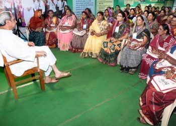 File photo of CM Naveen Patnaik interacting with SHG members