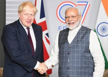 Boris Johnson (left) and Narendra Modi. File pic