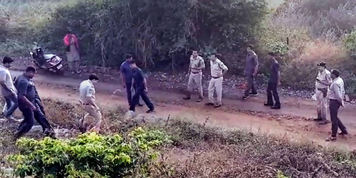 Police officials inspect the spot where the encounter took place leading to the death of all the four accused in the Hyderabad gangrape and murder case