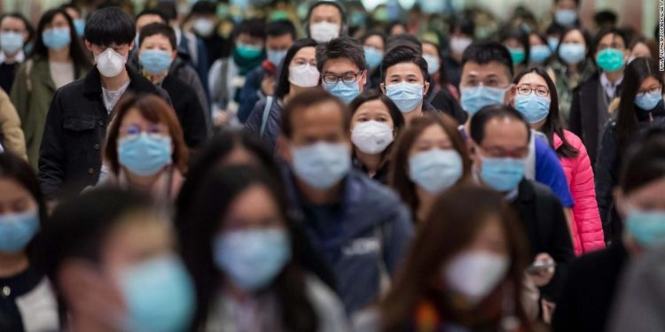 Commuters wearing protective masks walk through Hong Kong Station, operated by MTR Corp., in Hong Kong, China, on Wednesday, Jan. 29, 2020. Governments tightened international travel and border crossings with China as they ramped up efforts to stop the spread of the disease. Photographer: Paul Yeung/Bloomberg via Getty Images