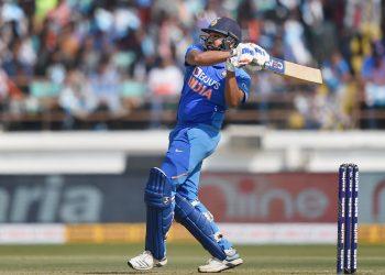 Rajkot: Indian batsman Rohit Sharma plays a shot during the second one day international (ODI) cricket match between India and Australia, at Saurashtra Cricket Association Stadium in Rajkot, Friday, Jan. 17, 2020.(