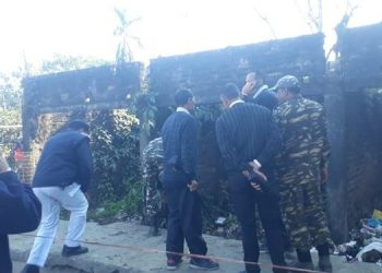 Security personnel examine a blast site at Dibrugarh