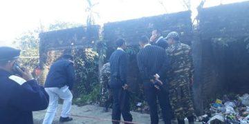 Security personnel examine a blast site at Dibrugarh