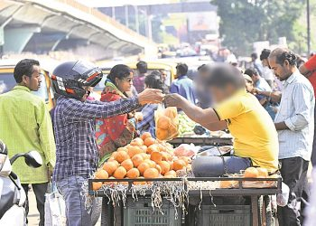 A vendor sells fruits in a polythene bag in Bhubaneswar