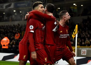Liverpool players celebrate with Roberto Firmino (2nd left) after he scored the winning goal Thursday