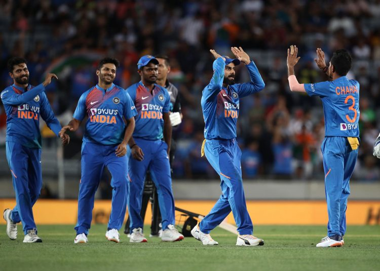 The Indians celebrate the fall of a New Zealand wicket