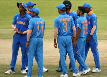 Indian players celebrate the fall of a Japan wicket