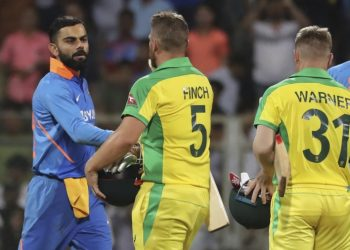 Virat Kohli congratulates Aaron Finch after the first ODI in Mumbai