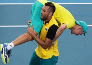 Nick Kyrgios celebrates with a teammate after Australia's win