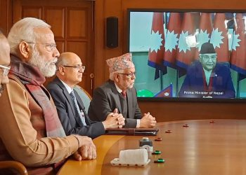 Prime Minister Narendra Modi and his Nepalese counterpart KP Sharma Oli (on the screen) jointly inaugurate the second Integrated Check Post at Jogbani-Biratnagar,