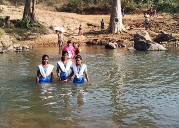 Crossing river routine for these school-going kids