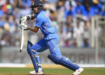 Shikhar Dhawan who top scored for India drives during the match against Australia