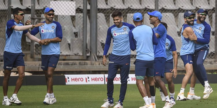 Indian players share a light moment during the training session Monday