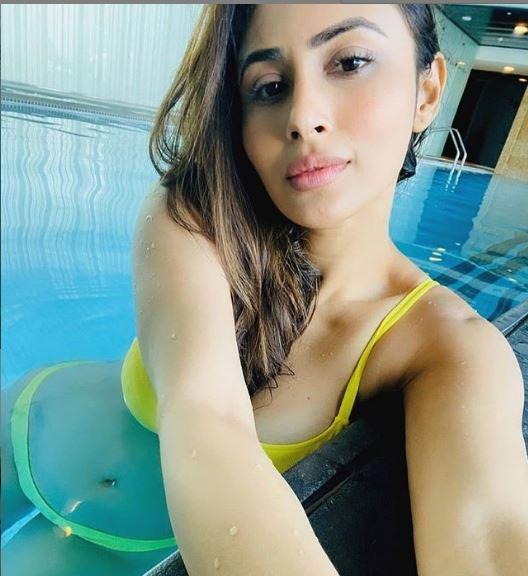Mouni Roy ups hotness quotient in a bikini; see pics - newsdezire