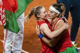 Aryna Sabalenka and Aliaksandra Sasnovich celebrate Belarus' place in the Fed Cup finals (AFP Photo/Ronald HOOGENDOORN)