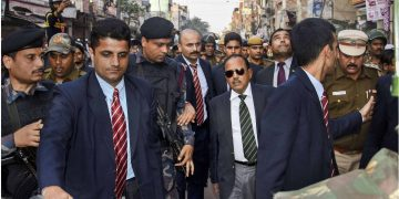 NSA Ajit Doval inspects a violence-hit area in northeast delhi