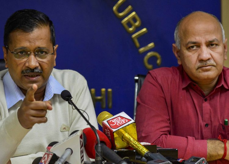 Delhi Chief Minister Arvind Kejriwal and his deputy Manish Sisodia talk to the media in New Delhi, Thursday