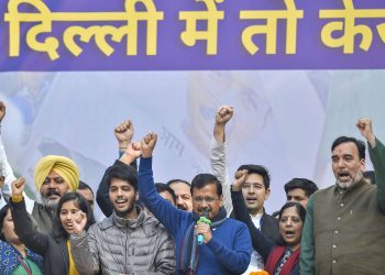 Arvind Kejriwal with family members and AAP leaders celebrate the party's victory Tuesday