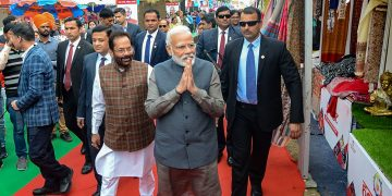 Prime Minister Narendra Modi with Minority Affairs Minister Mukhtar Abbas Naqvi during a surprise visit to 'Hunar Haat'