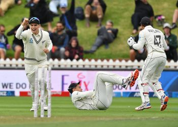 Ross Raylor (on ground) made his 100th Test memorable by catching Virat Kohli