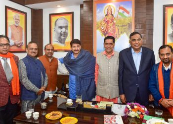 Manoj Tiwari (C) and other leaders of the BJP's Delhi unit during a meeting Wednesday