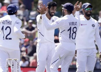 Jasprit Bumrah celebrates with teammates after dismissing a New Zealand batsman