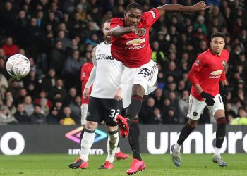 Odion Ighalo scores his second goal against Derby county as former Man U legend Wayne Rooney (32) watches