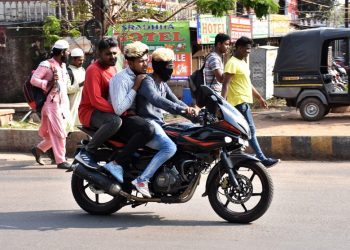 Triple riding sans helmets continues unabated in Capital city amidst heavy crackdown on unruly motorists, Monday