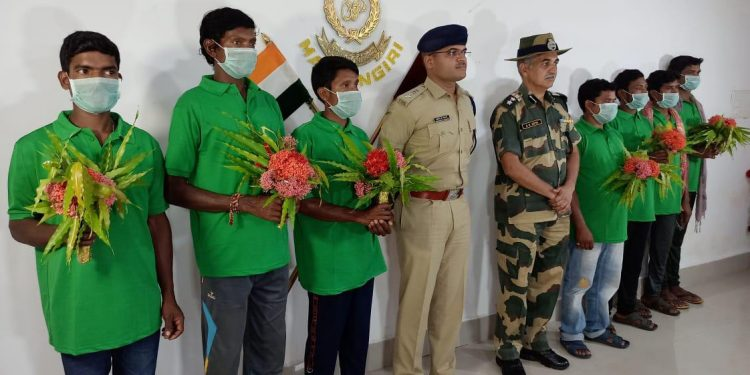 Malkangiri SP Rishikesh D Khilari and other officials with the seven Maoists who surrendered