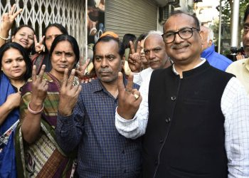 Nirbhaya's parents (2nd and 3rd from left) flash the 'V' sign after the hanging of the convicts