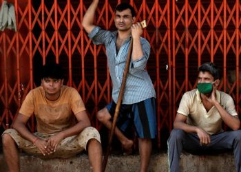 Migrant workers, who work in textile looms, are seen outside a loom after it was shut due to nationwide lockdown to slow the spread of the coronavirus disease, in Bhiwandi on the outskirts of Mumbai (Photo: Reuters/Francis Mascarenhas)