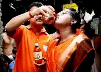 Cow urine being given to a devotee in Kolkata