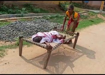 Woman drags cot with ailing centenarian mother on to the bank for Rs.1500