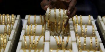 A salesman arranges gold bangles inside a jewellery showroom. (File photo, Reuters)