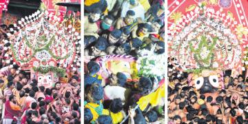 Lord Balabhadra, Devi Subhadra and Lord Jagannath being taken to the sanctum sanctorum of Srimandir from their respective chariots through Goti Pahandi  on the occasion of Niladribije, Saturday