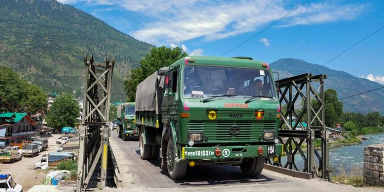 Indian army trucks depart towards Ladakh amid standoff between Indian and Chinese troops in eastern Ladakh, at Manali-Leh highway in Kullu district. (PTI Photo)