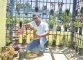 This railway department employee makes best use of discarded plastic drinking water bottles