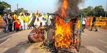Punjab Youth Congress activists set on fire a tractor near India Gate during a protest against the new farm laws, in New Delhi. (PTI Photo)