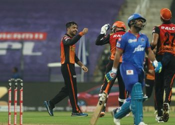 Rashid Khan (L) celebrates with teammates after dismissing a DC batsman, Tuesday