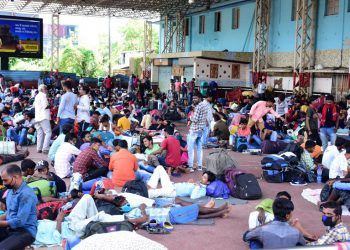 Throwing COVID-19 guidelines to winds, travellers wait at Bhubaneswar railway station, Monday