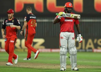 Chris Gayle shows off 'The Boss' sticker on his bat after reaching 50 against RCB in Sharjah, Thursday