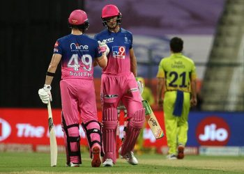 Jos Buttler (R) and Steve Smith congratulate each other after completing 50 runs of partnership against CSK in Abu Dhabi, Monday